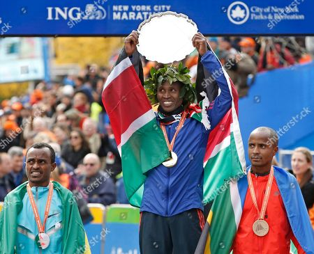 Tsegaye Kebede, Geoffrey Mutai, Lusapho April Second place finisher Tsegaye Kebede, left, of Ethiopia, and third-placed Lusapho April, right, of South Africa, flank men's winner Geoffrey Mutai of Kenya after finishing the New York City Marathon, in New York