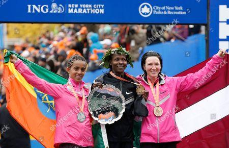 Buzunesh Deba, Priscah Jeptoo, Jelena Prokopcuka Women's winner Priscah Jeptoo of Kenya, center, second place finisher Buzunesh Deba of Ethiopia, left, and third place finisher Jelena Prokopcuka of Latvia pose after the New York City Marathon, in New York