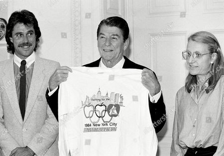 Dixon Reagan Waitz Ronald Reagan poses with a T-shirt presented to him by Grete Waitz of Norway and Rod Dixon of New Zealand, winners of the New York City Marathon