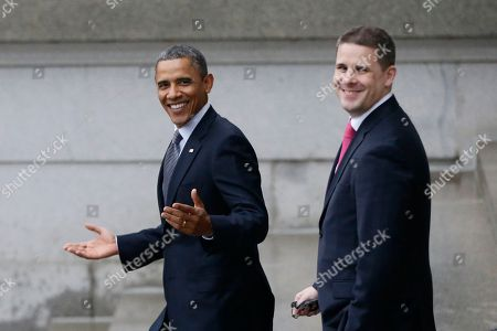 Barack Obama, Dan Pfeiffer President Barack Obama, accompanied by White House Communications Director Dan Pfeiffer, reacts to a reporter's question about the event he was leaving at the Treasury Department for outgoing Treasury Secretary Timothy Geithner, in Washington