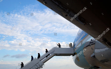 Barack Obama, Michelle Obama, Malia Obama, Sasha Obama, Marian Robinson President Barack Obama follows first lady Michelle Obama, daughters Malia and Sasha and first lady's mother Marian Robinson down the stairs during their arrival on Air Force One, . At Andrews Air Force Base, Md