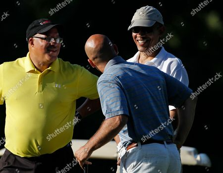 Eric Whitaker, Sam Kass, Barack Obama In this, President Barack Obama, right, chats with Eric Whitaker, left, and Sam Kass, center, while playing golf in Vineyard Haven, Mass. Whitaker is one of the circle of tight-lipped friends, forming a core with Martin Nesbitt and Valerie Jarrett, who've sustained Barack Obama through good times and bad since his days in Chicago, from Hawaii to Washington to Martha's Vineyard and back again. They golf with him, they vacation with him, their kids and his kids hang out. To them, he's Barack, not Mr. President. He can be teased and tease back