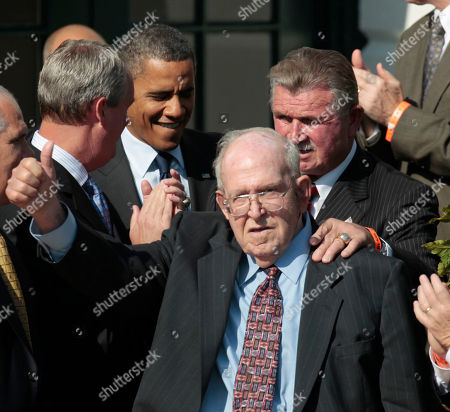 Former Bears' defensive coordinator Buddy Ryan gestures as he walks in with former head coach Mike Ditka, and President Barack Obama, during an event honoring the 1985 Super Bowl XX Champions Chicago Bears football team on the South Lawn of the White House in Washington. Buddy Ryan, who coached two defenses that won Super Bowl titles and whose twin sons Rex and Rob have been successful NFL coaches, died . He was 82