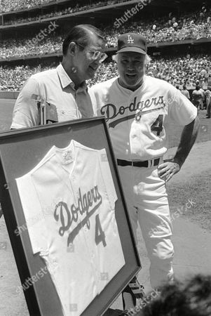 "Duke Snider, Peter O?Malley Former Brooklyn and Los Angeles Dodger Duke Snider, right, accepts a jersey with his No. 4, retired by the Dodgers, from club president Peter O'Malley at Dodger Stadium in Los Angeles. Snider, 84, died early, of what the family called natural causes at the Valle Vista Convalescent Hospital in Escondido, Calif. Snider was part of the charmed ""Boys of Summer"" with the Dodgers in the late 1940s and 1950s. He helped lead Brooklyn to its only World Series championship in 1955"