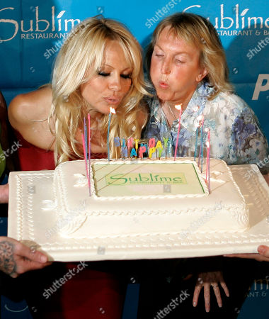 Pamela Anderson; Ingrid Newkirk Pamela Anderson and PETA President Ingrid Newkirk, right, blow out birthday candles as they arrive for Anderson's 40th birthday party at the Sublime cafe in Fort Lauderdale, Fla. . She was celebrating her birthday at the vegan hotspot with fellow PETA members