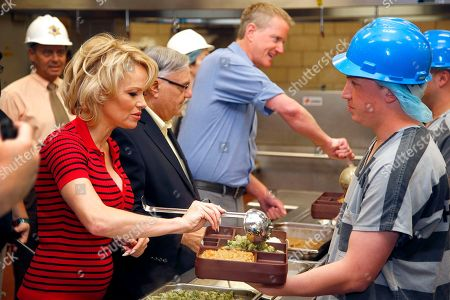 Pamela Anderson, Joe Arpaio, Dan Matthews Actress Pamela Anderson, left, joins Maricopa County Sheriff Joe Arpaio, second from left, and PETA Senior Vice President Dan Mathews, middle, as they serve the first all-vegetarian meal to inmates at the Maricopa County Jail, in Phoenix. Anderson, a PETA honorary director and long-time vegan, also toured Tent City after serving meals to the inmates
