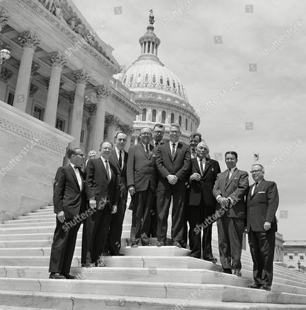 Rep. John B. Anderson (R-Ill.); poses at the U.S. Capitol in Washington, with a group from Freeport, Ill., to discuss Pecatonica River flood control. From left are: W.A. Stevens, legislative assistant to Sen. Everett Dirksen (R-Ill.); Hugh L. Grow, Freeport Chamber of Commerce; K.M. McGrath of Sen. Paul Douglas (D-Ill.), office; Freeport Mayor Joe D. Shelby; Rep. Anderson; Nick Servatins, president, Modern Planting Corp.; Judge Marvin E. Burt, and Ernest E. Wright, president, Freeport Chamber of Commerce. (Back row, from left) Robert J. Schmelzte, corporation council; and Joseph A. Fisher, of the Rockford Star