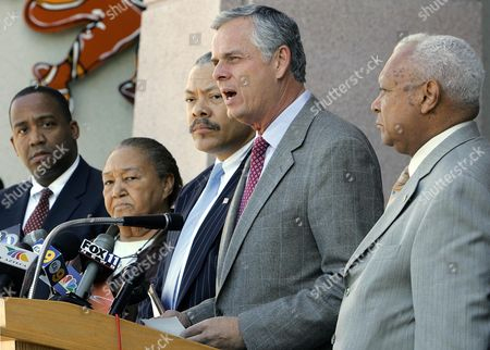"MACK Los Angeles Mayor James Hahn, second from right, is joined by, from left, Los Angeles Police Dept. Inspector General Andre Birotte Jr., community activist ""Sweet"" Alice Harris, police commission president David Cunningham III, and, right, Urban League president John Mack, as he criticizes the district attorney's decision not to file charges against an LAPD officer who was videotaped clubbing a car-theft suspect with a flashlight, during a news conference in Los Angeles"