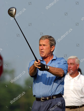 BUSH President Bush tees off at the first hole during a golf game at Andrews Air Force Base, Md., . The president was playing with Commerce Secretary Don Evans, Roland Betts, a personal friend, and Mike Thomas, clubhouse manager for the golf course, background