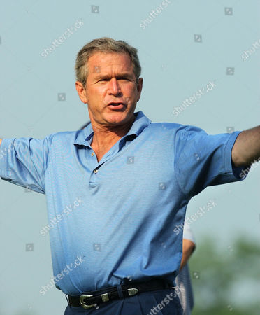BUSH President Bush reacts after teeing off at the first hole during a golf game at Andrews Air Force Base, Md., . The president was playing with Commerce Secretary Don Evans, Roland Betts, a personal friend, and Mike Thomas, clubhouse manager for the golf course