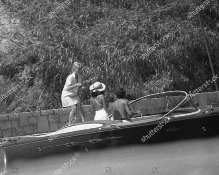 Editorial picture of RIKKY VON OPEL AND BIANCA JAGGER IN ST TROPEZ, FRANCE -  JUL 1976