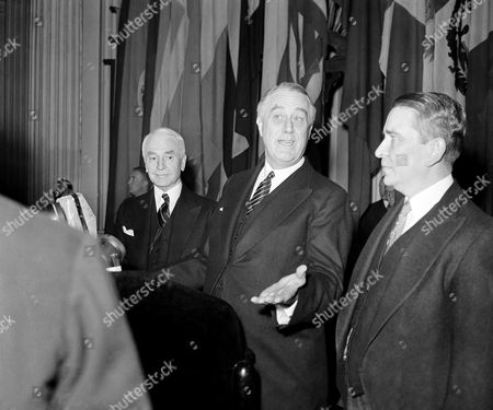 "Franklin Delano Roosevelt, Cordell Hull Appearing before the governing board of the Pan American Union on the observance of the union's 50th anniversary in Washington, President Franklin D. Roosevelt deplored wars abroad as ""more horrible and destructive than ever"" and said the Americans could keep open the way to eventual peace ""only if we are prepared to meet force with force if challenge is ever made."" Mr. Roosevelt with Secretary of State Cordell Hull, right, and Dr. Hector David Castro, vice chairman of the governing board of the union and minister from El Salvador"