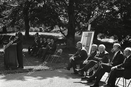 """Stock Image of John Kennedy, Peter Schoenman, Gaylord Nelson, Lyndon Johnson, Ivan Nestingen, Theodore Brazeau Federal officials and the Wisconsin governor are among dignitaries listening to President John Kennedy speak at a ceremony on the House lawn in Washington . The occasion was the unveiling of a postage stamp commemorating enactment Wisconsin of the first workmen's compensation law. Seated, from left, are: Peter Schoeman AFL-CIO Vice President; Agriculture Secretary Freeman; Gov. Gaylord Nelson, """"isconsin; Laboratory Secretary Goldberg; Treasury Secretary Dillon; Vice President Johnson; Postmaster General Commerce Secretary Hodges; Welfare Undersecretary Ivan Nestingen, and Theodore Brazeau, Rapids, member of the 1911 Wisconsin legislature which passed the bill"""