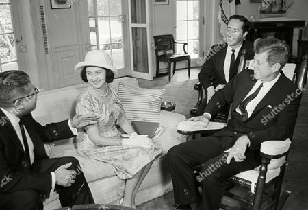 President John Kennedy chats with Mrs.Eva Lopez Mateos, wife of the president of Mexico, Adolfo Lopez Mateos, during a visit at the White House. At left is Mexican Ambassador Antonio Carrillo Flores, and in the background is Donald Barnes, a state department interpreter. The Mexican president was not present
