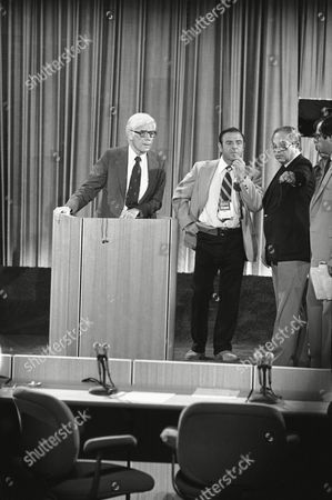 Independent presidential candidate John Anderson, left, checks out the podium for his debate with Republican presidential candidate Ronald Reagan, Sept. 21,1980, in Baltimore, Md. At right, is David Garth, Anderson's media adviser. At center is an unidentified television technician