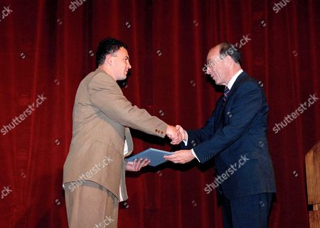 Greg Marinovich, Michael I. Sovern Associated Press Greg Marinovich, left, accepts his Pulitzer Prize in Spot News Photography from Columbia University President Michael I. Sovern at Columbia University in New York, . Marinovich won for a series of photos depicting factional violence in South Africa
