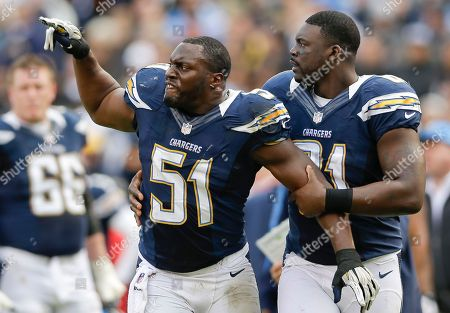Takeo Spikes, Randy McMichael San Diego Chargers inside linebacker Takeo Spikes, left, is restrained by teammate Randy McMichael during the first half of an NFL football game against the Oakland Raiders, in San Diego. Takeo had just been ejected from the game