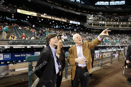 """Ken Burns, Lynn Novick, Chuck Armstrong Seattle Mariners president Chuck Armstrong, right, talks about the features of the roof at Safeco Field with documentary filmmakers Ken Burns, left, and Lynn Novick, center, prior to a baseball game between the Texas Rangers and the Seattle Mariners, in Seattle. Burns and Novick co-directed """"Baseball The Tenth Inning,"""" which will air on PBS in late September"""