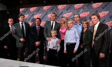 Nicklas Lidstrom, Ken Holland, Lucas Lidstrom, Annika Lidstrom, Samuel Lidstrom, Christopher Ilitch, Marian Ilitch, Mike Ilitch, Adam Lidstrom, Mike Babcock From left, Christopher Ilitch, president and CEO of Ilitch Holdings, Mike Babcock, Detroit Red Wings head coach, Ken Holland, team general manager and Executive Vice President, Nicklas Lidstrom, Lucas Lidstrom, Annika Lidstrom, Samuel Lidstrom, Adam Lidstrom, Red Wings owners Marian and Mike Ilitch, stand for a group photo after Lidstrom announced his retirement in Detroit