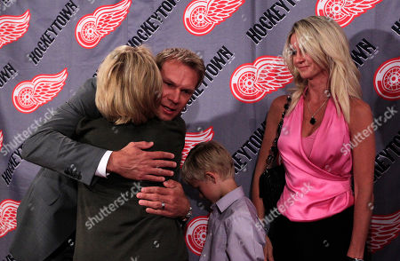 Nicklas Lidstrom, Annika Lidstrom Detroit Red Wings captain Nicklas Lidstrom of Sweden hugs team owner Marian Ilitch next to his wife Annika after announcing his retirement during a news conference in Detroit, . Lidstrom retires after a 20-season career