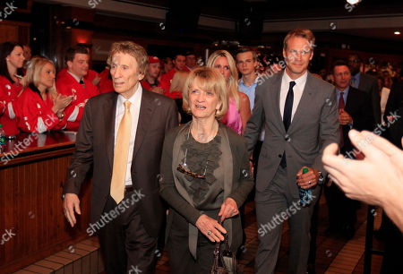 Nicklas Lidstrom, Annika Lidstrom, Mike Ilitch, Marian Ilitch Detroit Red Wings owners Mike and Marian Ilitch, foreground, are followed by team captain Nicklas Lidstrom of Sweden and his wife Annika, as they arrive for the news conference where Lidstrom announced his retirement, in Detroit, . Lidstrom retires after a 20-season career