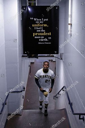 Modesto Lacen Actor Modesto Lacen, a friend of the family of Pittsburgh Pirates Hall of Famer Roberto Clemente impersonates Roberto Clemente as he walks up the stairs from the field after a ceremony honoring the 40th anniversary the Roberto Clemente's 3000th hit before a baseball game between the Pittsburgh Pirates and Cincinnati Reds in Pittsburgh