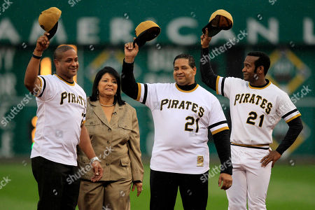 Modesto Lacen, Roberto Clemente Jr, Luis Clemente, Vera Clemente Vera Clemente, second from left, and her sons, Roberto Clemente Jr., left, and Luis Clemente, second from right acknowledge the fans after a ceremony honoring the 40th anniversary of Pittsburgh Pirates Hall of Famer Roberto Clemente's 3000th hit before a baseball game between the Pittsburgh Pirates and Cincinnati Reds in Pittsburgh . With the Clemente family is actor Modesto Lacen, right, a family friend who was impersonating Roberto Clemente for the occasion