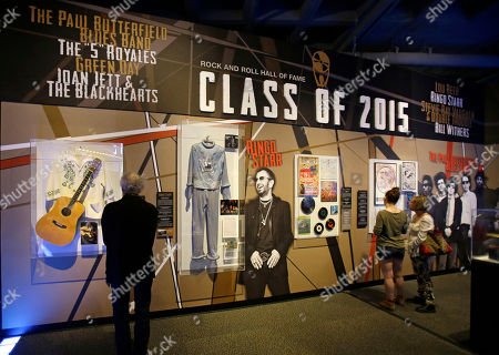 "People look at the Class of 2015 exhibit at the The Rock and Roll Hall of Fame and Museum, in Cleveland. Ringo Starr, who was previously enshrined with the Beatles in 1988, will be honored along with pop punks Green Day, soul singer-songwriter Bill Withers, underground icon Lou Reed, guitarist Stevie Ray Vaughan and Double Trouble, Joan Jett and The Blackhearts, The Paul Butterfield Blues Band and The ""5"" Royales"