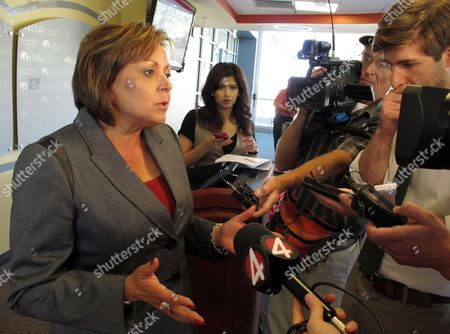 """Stock Photo of Susanna Martinez New Mexico Gov. Susana Martinez talks to reporters about GOP presidential nominee Mitt Romney's comments in a secret video to wealthy donors that 47 percent of all Americans """"believe they are victims"""" entitled to extensive government support, at the University of New Mexico in Albuquerque"""