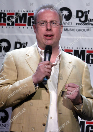 Steve Bartels, President of Island Def Jam Recordings Music Group gestures during a news conference in New York, . Bartels joined Russell Simmons to announced the formation of a joint label venture with DEF Jam Music Group named The Russell Simmons Music Group