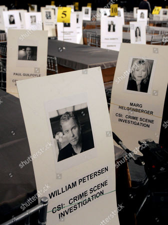 """PLACARDS Placards hold the seats of nominees from the television series """"CSI: Crime Scene Investigation,"""" including William Petersen, Marg Helgenberger and Paul Guilfoyle,back left, during rehearsals for the upcoming 11th annual Screen Actors Guild Awards at the Shrine Auditorium in Los Angeles . The SAG awards will be presented Saturday, Feb. 5"""