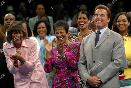 """EVANS California Gov. Arnold Schwarzenegger shares a laugh as he is referred as """"The Terminator, with Angela Evans, far left, President of the Crenshaw Christian Center, and Betty Price, middle, wife of Pastor and Founder Frederick Price, not seen, during a service, at the Crenshaw Christian Center in Los Angeles. Behind the Governor are the pastor family members: Cheryl Price, and Adrian Evans"""