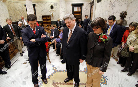 Stock Picture of Chris McDaniel, Ben James Jr., Laura Leigh James Sen. Chris McDaniel, R-Ellisville left joins newly appointed Senate Chaplain Rev. Ben James Jr., center, and his wife Laura Leigh James in prayer at the capital in Jackson, Miss. James, pastor of Prentiss Baptist Church, was appointed to the non-paid post and will be on duty at least one-day a week