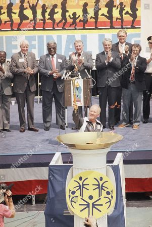 Sargent Shriver, Robert Orr, Harold Washington, Edwin Mees As ceremony participants, left to right, Indiana Gov. Robert Orr, Chicago Mayor Harold Washington, U.S. Atty. Gen. Edwin Meese and Special Olympics International President Sargent Shriver watch Special Olympian Timothy Corrigan raise the lighted torch during ceremonies in Chicago, . The torch is being relayed from Chicago to South Bend, Ind., where the Special Olympic International Games open on August 2