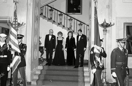 Nancy Reagan, Margaret Thatcher, Ronald Reagan, Denis Thatcher President Ronald Reagan escorts British Prime Minister Margaret Thatcher to the state floor of the White House for a state dinner, Thursday, February 26 in Washington. Mrs. Thatcher?s husband, Denis, and first lady Nancy Reagan are on the left