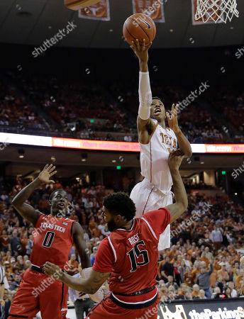 Keenan Evans, Aaron Ross Texas Tech guard Keenan Evans (12) shoots over Texas Tech forward Aaron Ross (15) during the second half of an NCAA college basketball game, in Austin, Texas. Texas won 69-59