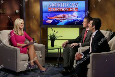 "Ainsley Earhardt, Eric Trump, Donald Trump Jr Fox News host Ainsley Earhardt interviews Eric Trump, center, and Donald Trump Jr., sons of Republican presidential candidate Donald Trump, during her debut as co-host of the network's morning show ""Fox & Friends"" television program, in New York, . Earhardt replaces Elisabeth Hasselbeck on the""curvy couch"" with Steve Doocy and Brian Kilmeade"