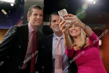 "Stock Image of Ainsley Earhardt, Eric Trump, Donald Trump Jr Fox News' Ainsley Earhardt takes a selfie with Eric Trump, left, and Donald Trump Jr., sons of Republican presidential candidate Donald Trump, during her debut as co-host of the network's morning show ""Fox & Friends"" television program, in New York, . Earhardt replaces Elisabeth Hasselbeck on the""curvy couch"" with Steve Doocy and Brian Kilmeade"