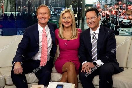 "Stock Picture of Ainsley Earhardt, Steve Doocy, Brian Kilmeade Fox News host Ainsley Earhardt makes her debut as co-host of the network's morning show ""Fox & Friends"" television program, in New York, . Earhardt replaces Elisabeth Hasselbeck on the""curvy couch"" with Steve Doocy, left, and Brian Kilmeade"