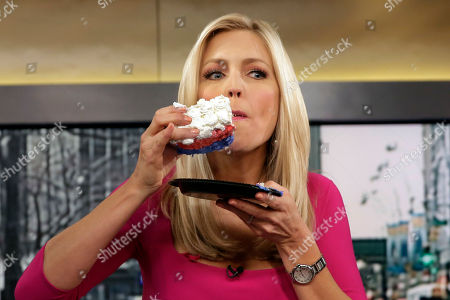 "Ainsley Earhardt Fox News host Ainsley Earhardt eats a piece of a celebratory cake during her debut as co-host of the network's morning show ""Fox & Friends"" television program, in New York, . Earhardt replaces Elisabeth Hasselbeck on the""curvy couch"" with Steve Doocy and Brian Kilmeade"