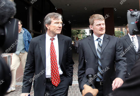 """Stock Picture of Floyd Landis, Leo Cunningham Floyd Landis, right, and his attorney, Leo Cunningham, leaving federal court in San Diego. The International Cycling Union says it won a Swiss court ruling prohibiting Landis from repeating claims that its leaders corruptly protected Lance Armstrong from a doping case. The governing body says the defamation judgment """"upholds and protects the integrity of the UCI and its presidents"""