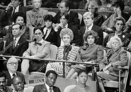 Nancy Reagan sits in front of her son, Ronald Prescott Reagan, and his wife Doria, left, as they hear President Reagan address the UN General Assembly, in United Nations. Others, from left, Mrs. Jorge Illueca, wife of the UN General Assembly President, Nancy Reagan, Marcela Temple Seminario, wife of UN Secretary General Javier Perez de Cuellar, and Helena Maria Shultz, wife of George Shultz, U.S. Secretary of State
