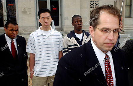 Stock Image of Jordan Lorence, right, representing Alpha Iota Omega, speaks during a news conference outside the U.S. District Court, after a hearing between the religious fraternity, Alpha Iota Omega, and the University of North Carolina-Chapel Hill, in Greensboro, N.C. Alpha Iota Omega president Tremayne Manson, of Durham, N.C., left, Jonathan Park, second from left, a UNC-CH junior from California, and fraternity chapter president Trevor Hamm, a UNC-CH senior from Kinston, N.C., wait to speak in background. The fraternity filed suit against UNC-CH in August of 2004 when they were stripped of official campus recognition for requiring members to be Christian