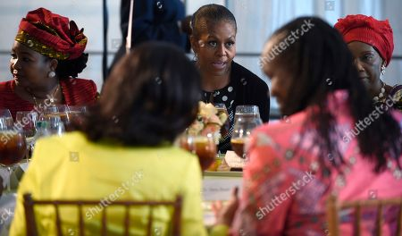 """Michelle Obama, Salma Kikwete, Gertrude Hendrina Mutharika First lady Michelle Obama attends a spouses luncheon during the """"Investing in our Future"""" program at the Kennedy Center in Washington, . Michelle Obama and Laura Bush, first ladies of different generations and opposing political parties, are uniting for the second time in just over a year to promote U.S. relations with Africa. Obama is flanked by first lady of Tanzania Salma Kikwete, left, and first lady of Malawi Gertrude Hendrina Mutharika"""