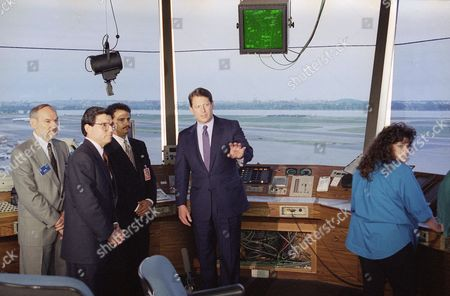 Al Gore, Shawn Thompson U.S. Vice President Gore, right, accompanied by Shawn Thompson, plans and procedures specialist, Federal Aviation Administration, center, and Transportation Secretary Federico Pena, tours the air traffic control center at Washington's National Airport, . The Clinton administration proposed on Tuesday to turn over the air traffic control system to a corporation