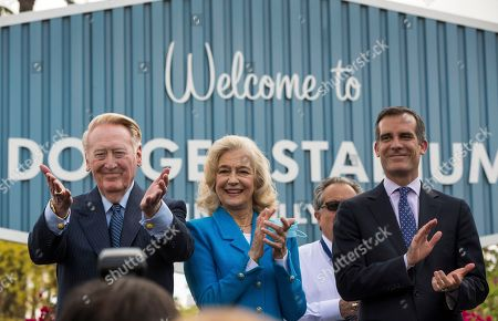 Vin Scully, Sandra Hunt Dodger legend Vin Scully, left, with his wife, Sandra Hunt, thanks Dodgers' fans at a dedication ceremony unveiling a street sign of his namesake at the entrance to Dodger Stadium in Los Angeles on . At right is Los Angeles Mayor Eric Garcetti. Despite some opposition, the Los Angeles City Council on Friday officially renamed Elysian Park Avenue after the revered announcer, who's been the voice of the Dodgers for 67 years