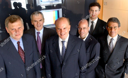 Randy Falco, far left, group president of NBC Television Network, Jean-Bernard Levy, second from left, chief operating officer of Vivendi Universal, Bob Wright, third from left, chairman of NBC and vice chairman of GE, Jeff Zucker, third from right, president of NBC Entertainment, Brandon Burgess vice president of business development at NBC and Ron Meyer, right, president and chief operating officer of Vivendi Universal Entertainment, together at Wright's office in New York, . Vivendi Universal and General Electric Co. reached an agreement to merge the French company's Hollywood studio, cable TV networks and theme parks with GE's NBC TV business