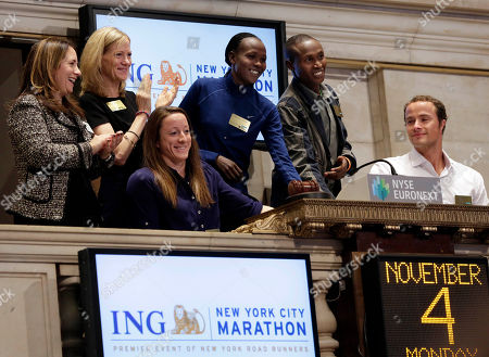Geoffrey Mutai, Priscah Jeptoo, Mary Wittenberg, Christine Sandler New York City marathon winners Geoffrey Mutai, fourth left, and Priscah Jeptoo, second from right, of Kenya, with wheelchair winners Tatyana McFadden, from Baltimore, Md., and Marcel Hug, right, of Switzerland, are applauded by New York Road Runners President & CEO Mary Wittenberg, second left, and NYSE Senior Vice President Christine Sandler, as they ring the New York Stock Exchange opening bell