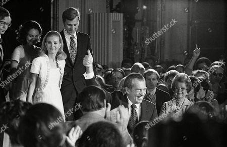 RICHARD NIXON A smiling President Nixon gives a thumbs up as he walks from the podium in the East Room of the White House . Nixon's daughters Julie Nixon Eisenhower, left and Tricia Nixon Cox and son-in-law Edward Cox follow