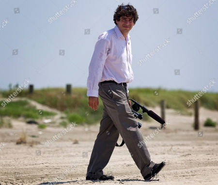 Arun Chaudhary White House videographer Arun Chaudhary walks to photograph President Barack Obama in Port Fourchon, La., as he tours areas affected by the disastrous oil spill in the Gulf of Mexico
